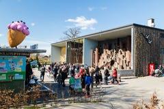 People in Copenhagen Zoological Garden. COPENHAGEN, DENMARK - APRIL 18, 2015: The popular Danish tourist attraction The Copenhagen Zoological Garden welcomes royalty free stock photography