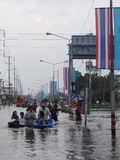 People are coping with the flood in their town of Pathum Thani, Thailand, in October 2011.  Stock Photos