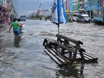 People are coping with the flood in their town of Pathum Thani, Thailand, in October 2011.  Stock Photo