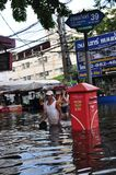 People are coping with the water in a flooded street of Bangkok, Thailand in October 2011.  Royalty Free Stock Photo