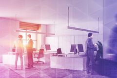 People in corner of white and wooden office royalty free stock photography