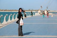 People at the Corniche road in Abu Dhabi, United Arab Emirates. UAE, ABU DHABI, FEBRUARY 4, 2016: People at the Corniche road in Abu Dhabi, the capital of United royalty free stock image