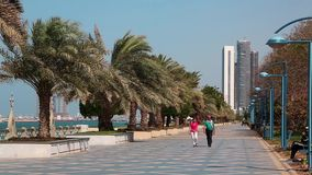 People at the Corniche road in Abu Dhabi, United Arab Emirates stock video footage