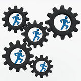 People corporate machinery. People in collaboration and teamwork in working together toward a common goal showin by people figures running in gear cogs Stock Photography