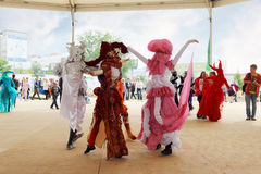 People in costume dancing on street theaters show at open air festival White Nights Royalty Free Stock Images