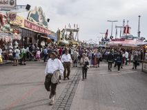 People in costume at the Oktoberfest. People in costume are strolling along between the attractions of th Oktoberfest, Munich, Germany royalty free stock photography