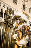 People in costumes and masks on Carnival in Venice Stock Photo