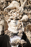 People in costumes and masks on Carnival in Venice. Venice is one of the most famous cities in Italy. It`s always full of tourists. The symbol of the city is the Royalty Free Stock Images
