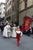 Italy, Florence. December 02, 2017 Costumed procession near Santa Maria del Fiore. People in the costumes of the Middle Ages - a procession through the streets Royalty Free Stock Photos