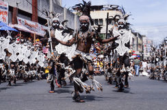 People on costumes at the parade of Ati-Atihan festival Royalty Free Stock Image