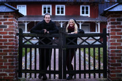 People: Couple in front of their house Royalty Free Stock Photo