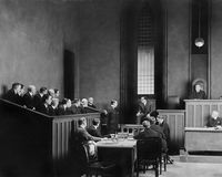 People in a courtroom. (All persons depicted are no longer living and no estate exists. Supplier grants that there will be no model release issues royalty free stock image