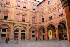 People in the courtyard of the Palazzo Comunale in Bologna. Stock Image