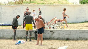 People covered with therapeutic mud at Techirghiol. Picture taken at Techirghiol lake.nnTechirghiol is a lake in Northern Dobrogea, Romania, near the town with Royalty Free Stock Photo