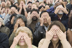 People Covering Eyes With Hands Stock Photo