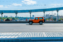 People cross Crimean bridge over the Moscow river Royalty Free Stock Photo