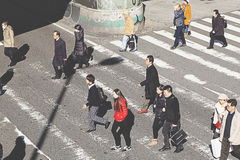 People cross the intersection in front of Osaka Station Stock Photos