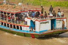 People cross Padma river on Daulatdia ferry boat at Chhota Dhulandi, Bangladesh. CHHOTA DHULANDI, BANGLADESH - FEBRUARY 19, 2014: Unidentified people cross Stock Photo