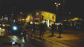 People cross the road in the night city stock footage