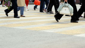 People cross the road at a pedestrian crossing stock footage