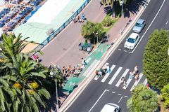 Nice, France - 16.09.16: people cross the road at the pedestrian crossing on the embankment of the city of Nice Royalty Free Stock Photos