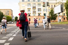 People cross the road on the pedestrian crossing royalty free stock photos