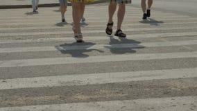People cross the road on a pedestrian crossing. Close-up crosswalk stock video