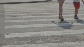 People cross the road on a pedestrian crossing stock video
