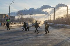 People cross the road in the winter stock images