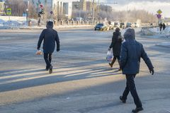 People cross the road in the winter royalty free stock photos