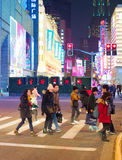 People cross Shanghai road, China. SHANGHAI, CHINA - DEC 28, 2016: People crossing a Nanjiing road in Downtown of Shanghai. The area is the main shopping Royalty Free Stock Photography