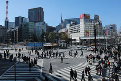 People cross a street in Japan. 's Ginza shopping district in Tokyo Stock Photo