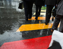 People cross street at rainy day Royalty Free Stock Photography