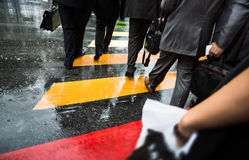People cross street at rainy day Stock Photography