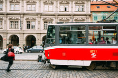 People cross the tram tracks on the street Malostranske namesti Stock Images