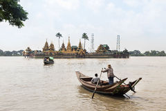 people cross yangon river by boat for pray at Ye Le Paya  pagoda the floating pagoda on small island Royalty Free Stock Photography