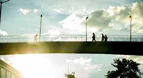 People crossing a bridge royalty free stock photography