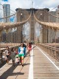 People crossing the Brooklyn Bridge in New York City Stock Photos