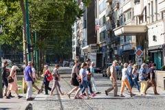 People crossing city street in Antwerp, Belgium Royalty Free Stock Photos