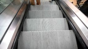 People on crossing Escalators stock video footage