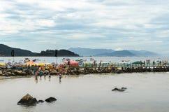 People crossing the footbridge to Ilha da Campanha Royalty Free Stock Photos