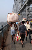 People crossing Howrah bridge in Kolkata. People crossing Howrah bridge where bear more than 100,000 vehicles and 150,000 pedestrians everyday, Kolkata, India Stock Photo