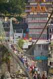 People crossing Lakshman Jhula bridge Royalty Free Stock Image