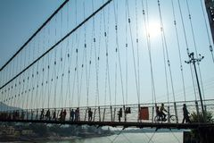 People crossing Lakshman Jhula bridge Stock Image