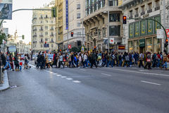 People crossing at the lights in Gran Via Stock Photo