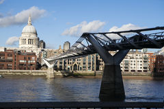 People crossing the Millennium Bridge over River Thames linking the City of London with the South Bank Stock Images