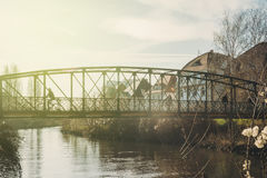 People crossing the old Ducrot passarelle bridge on a warm winte Royalty Free Stock Photo