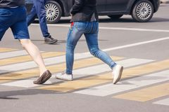 People crossing the pedestrian crossing royalty free stock photo