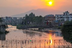 Sunset and polluted river
