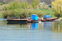 People are crossing river Dniester,Moldova stock photography